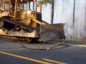 At one point, Godwin's hulking machinery takes to the road in order to execute and end-run on the fire.