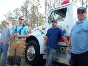 Capt. Terry Groome, right, and other members of the Aurora Volunteer Fire Department joined three units from Pamlico County – Triangle VFD, Goose Creek Island VFD, and Vandemere VFD – to contain the blaze until firefighters from the Forest Service arrived.