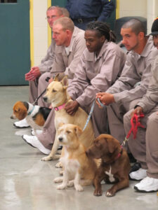 Dogs and inmate trainers share a bittersweet moment during Wednesday's graduation.