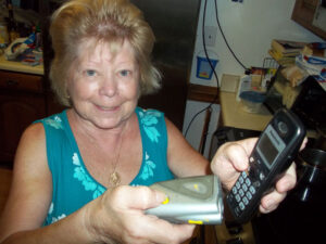 Mary Ann Martin demonstrates how she uses the 'Dog Off' alarm to discourage scammers who called almost incessantly over a two-day period.