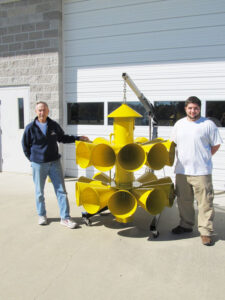 Bob Dales, left, and Matthew Barnett of the Southeast Pamlico Volunteer Fire Department display the trusty -- and recently refurbished -- siren.