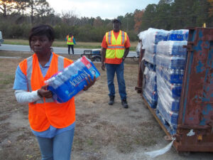 Workers distributed emergency water supplies late Wednesday to households affected by the vandalism.
