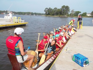 3) The local Oriental Dragon Boat Club now has access to a vessel that will allow almost year-round practice sessions. Seen here at the Wildlife Resources Commission boat ramp in Oriental, the club expresses its gratitude to Clancy's Marina where the Dragon Boat is stored.