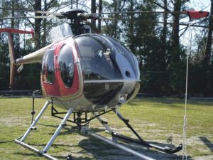 Pilot Will Nesbit flies a helicopter and operates an 'air saw' at the same time.