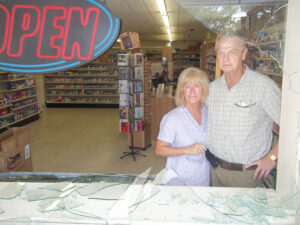 Framed Wednesday morning by the broken storefront window, Ed and Caroline Denton said violent break-ins are a threat to the entire community.