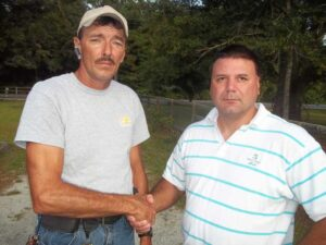 At left, Kenny Ross shakes hands with Mike Fuller, a day after their rescue efforts.
