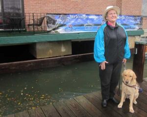 On a rainy day in Annapolis, Penny Zibula, with guide dog Otto, prepares to enter the world famous boat show.