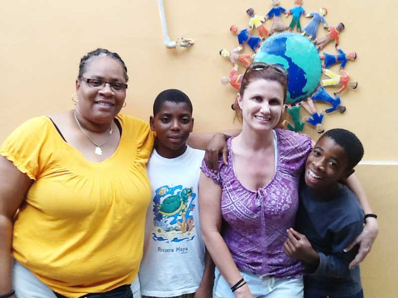 Hattie Harrell, left, and Melanie Campen with their young prayer partners at St. Joseph Home for Boys in Haiti.