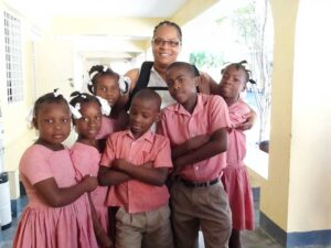 Hattie Harrell is surrounded by youngsters at the Blanchard school, located in a slum of the capital city.