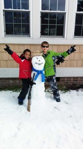 Jayden and Hayden Heath, ages 6 and 10, were too busy to worry about mailboxes as they went about building a gun-toting snowman during last week's storm.