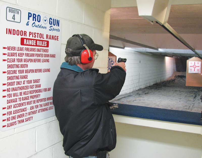 McCune shoots his new handgun at the indoor firing range of Pro-Gun & Outdoor Sports.