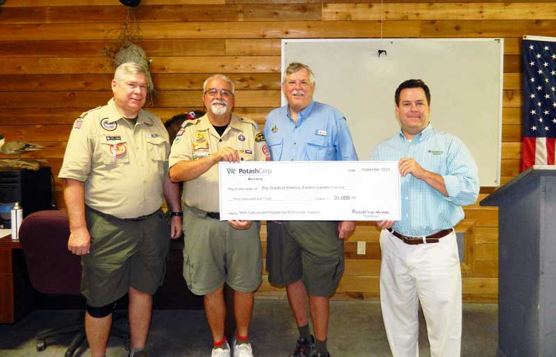 From left to right, Harry Sanders, Chocowinity; Norm Belmore, Council Commissioner, Jacksonville; Ray Franks, Scout Executive Greenville, receives a $30,000 check from Ray McKeithan of PotashCorp to support the PotashCorp ECO Lodge and Boy Scouts of America STEM Multicultural programs at the PotashCorp ECO Lodge Sunday.
