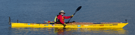 Deb Walter's kayak bears emblems and trademarks from various sponsors.