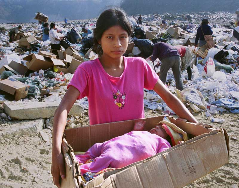 This 'Baby in a Box' photo demonstrates the dire plight of youngsters in Guatemala, who must fend for themselves in a huge garbage dump.