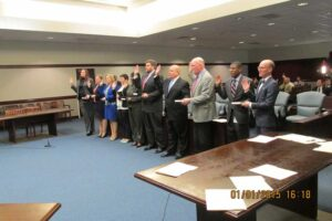 Assistant District Attorneys under Womble take their oaths. From left: Allycia Whitman, Emily Davis, Kimberly Pellini, Piper Ferguson, Toni Cameron, Lyle Burnham, Jeffrey Leahy, Reggie Williams, and Kyle Jones.