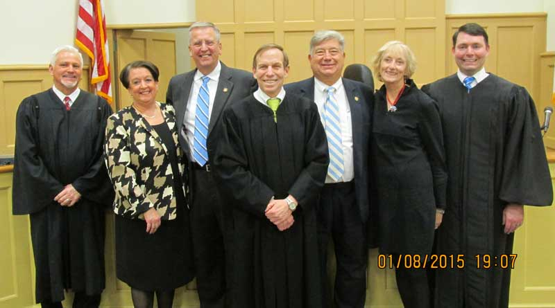 Bob Steinburg, left, and Bill Cook, seen here with their wives and judges, agreed to a joint ceremony in which they both took the Oath of Office for their seats in the state legislature.