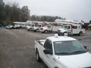 A fleet of trucks mustered in the parking lot of the elementary school in Bayboro.