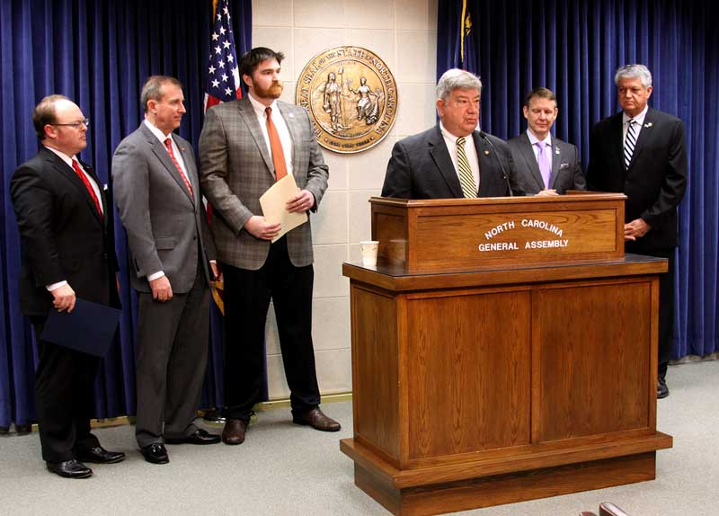 State Sen. Bill Cook (R-District 1) is shown Tuesday speaking at a press conference to announce his 'Property Insurance Fairness' legislation. From left are Insurance Commissioner Wayne Goodwin; state Sen. Harry Brown (R-District 6); Representative Chris Millis (R-District 16); Cook; Representative Mike Hager (R-District 112); and state Sen. Senator Norman W. Sanderson (R-District 2).