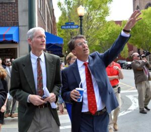 With Pepsi in hand, McCrory tours downtown New Bern with John Wood of the State Historic Preservation Office.