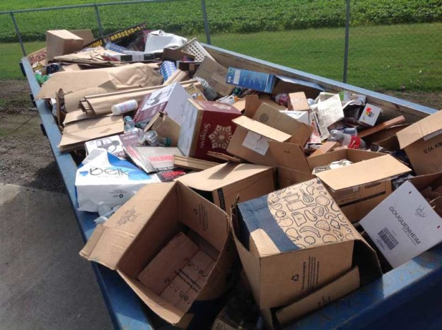 This cardboard, shown in a photo taken on July 4th, netted the county just $12 per ton, because it had not been properly sorted.