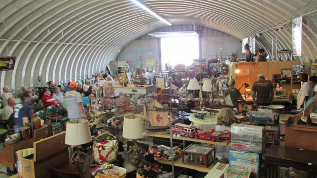 Bidders and merchandise fill a Quonset hut every other Saturday in Elizabeth City at Corner Market Auctions.