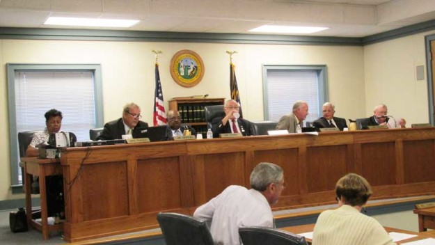 The Pasquotank County Board of Commissioners narrowly voted to proceed with the purchase of a heavy-duty truck though only one bid had been requested, a procedure known as 'sole source' purchasing.
