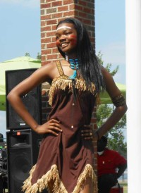 Contestants in the Miss Juneteenth and Juneteenth Princess pageants wore costumes depicting the nation's multi-culturalism. Here, Shenell Brown, age 13, performs wearing Native American garb.