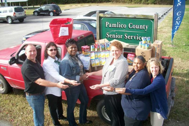 From left, Pamlico County Commissioner Kenny Heath; Senior Center Nutrition Director Beth Hardison; Senior Center Director Violet Ollison; and representing the Grantsboro Walmart: Store Manager Nancy Bass; Personnel Coordinator Kathy Bryant; and Office Associate Dianna Wetherell.