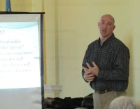 Alan Lennon used a slide presentation to divulge the true numbers behind wind energy's costs and benefits.