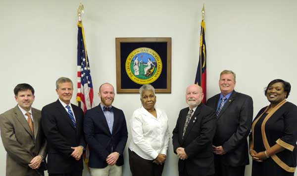 From left: Frank Heath (County Manager), and County Commissioners Wallace Nelson, Kyle Jones (Vice Chairman), Janice Cole (Chair), Edward Muzzulin, Matt Peeler, and Fondella Leigh