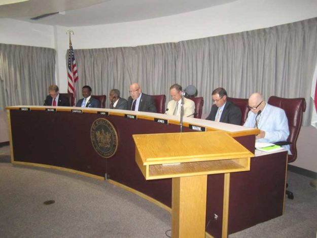 Seen here Monday night, from left: Craven County Commissioners Dacey, McCabe, Sampson, Liner, Tyson, Jones, and Mark.
