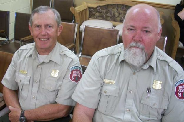 Monday night, Bossy Hardison, (left) the Pamlico County Forest Ranger; and Andy Meadows, District Forester, managed to eke out a commitment from the Pamlico County Commissioners to fund 40 percent of the cost for a new pickup truck. The two men will request the remaining funds from state government.